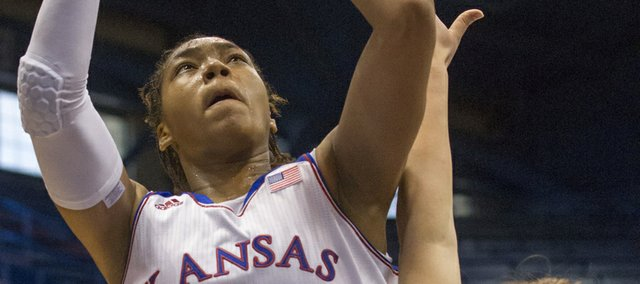 Kansas' Asia Boyd (0) creates contact as she shoots over Oral Roberts' Noora Jaervikangas (24) during their game Sunday afternoon at Allen Fieldhouse. The Jayhawks won their season opener, 84-62.