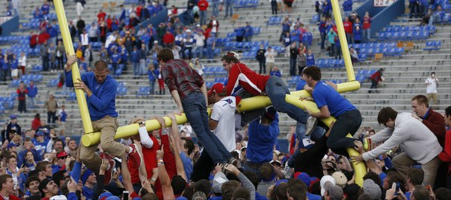 Kansas fans bring down the south goal post following the Jayhawks' 31-19 win over West Virginia on Saturday, Nov. 16, 2013 at Memorial Stadium.