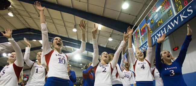 Kansas players celebrate their win following Kansas' volleyball match against in-state rival Kansas State, Saturday at the Horejsi Center. The Jayhawks defeated the Wildcats, 3-1.