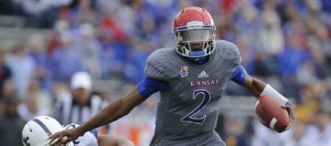 Kansas quarterback Montell Cozart pushes asid