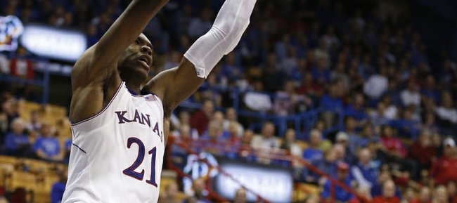 Kansas center Joel Embiid delivers a dunk against Pittsburg State during the second half of an exhibition game on Tuesday, Oct. 29, 2013 at Allen Fieldhouse.