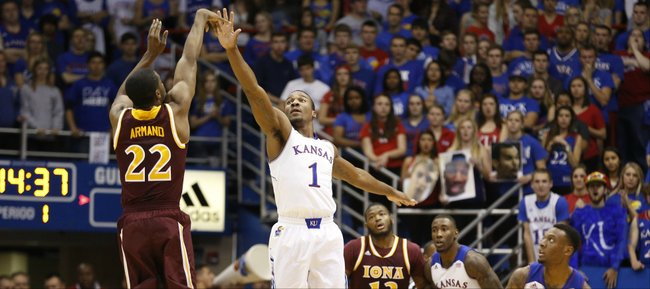 Kansas guard Wayne Selden guards a three by Iona guard Sean Armand during the first half on Tuesday, Nov. 19, 2013 at Allen Fieldhouse.