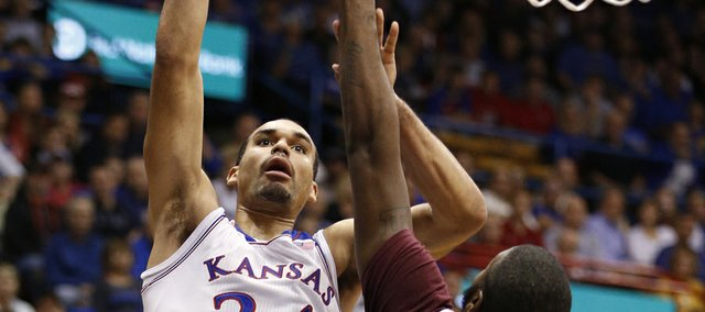 Kansas forward Perry Ellis puts up a bucket over Iona forward David Laury during the first half on Tuesday, Nov. 19, 2013 at Allen Fieldhouse.