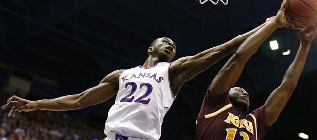 Kansas guard Andrew Wiggins fights for a rebound with Iona forward David Laury during the second half on Tuesday, Nov. 19, 2013 at Allen Fieldhouse.