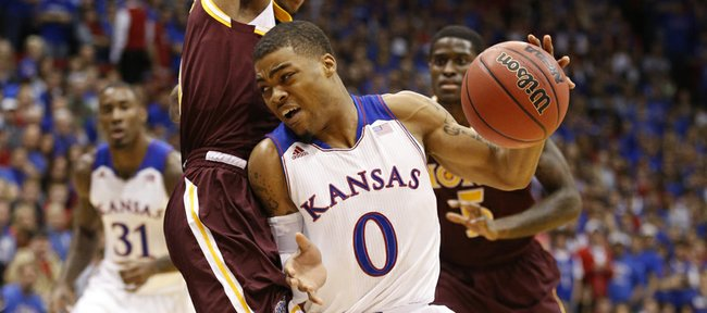 Kansas guard Frank Mason drives around Iona guard Isaiah Williams during the first half on Tuesday, Nov. 19, 2013 at Allen Fieldhouse.