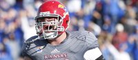 Opinion: Future fireman Spencer fights off defenders, injuries to make impact for KU