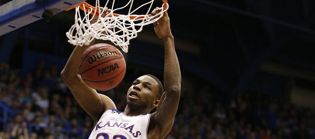 Kansas guard Andrew Wiggins delivers a dunk past Towson forward John Davis during the first half on Friday, Nov. 22, 2013 at Allen Fieldhouse.