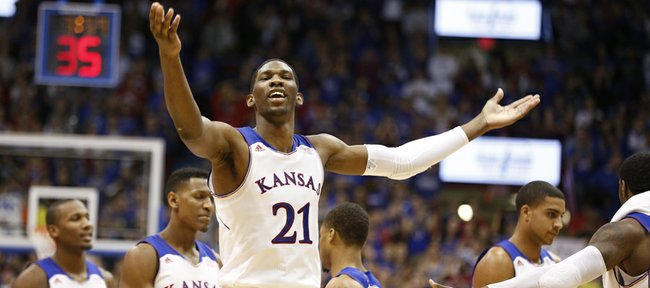 Kansas center Joel Embiid raises up the fieldhouse during a Jayhawk run in the second half on Friday, Nov. 22, 2013 at Allen Fieldhouse.