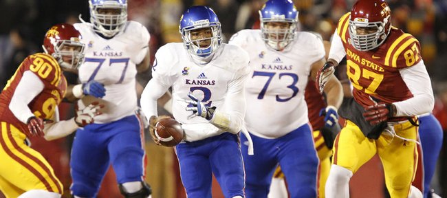 Kansas quarterback Montell Cozart takes off on a run against the Iowa State defense during the second quarter on Saturday, Nov. 23, 2013 at Jack Trice Stadium in Ames, Iowa.