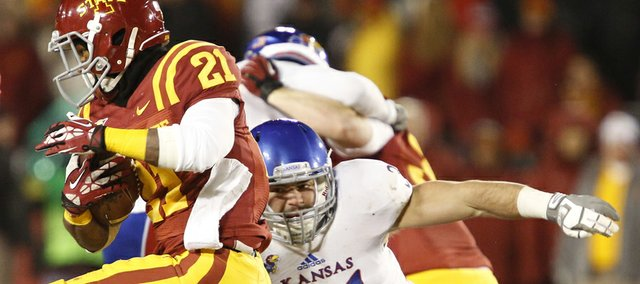 Kansas linebacker Ben Heeney reaches for Iowa State running back Shontrelle Johnson during the second quarter on Saturday, Nov. 23, 2013 at Jack Trice Stadium in Ames, Iowa.