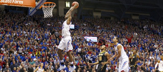 Thousands watch as Kansas guard Andrew Wiggins soars in for a jam on a breakaway against Towson during the first half on Friday, Nov. 22, 2013 at Allen Fieldhouse.