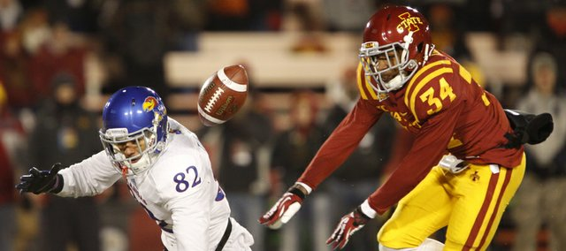 Kansas receiver Andrew Turzilli is tossed to the ground by Iowa State defensive back Nigel Tribune after bobbling a pass during the fourth quarter on Saturday, Nov. 23, 2013 at Jack Trice Stadium in Ames, Iowa.