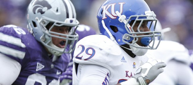 Kansas running back James Sims is trailed by the Kansas State defense during the third quarter on Saturday, Oct. 6, 2012 at Bill Snyder Family Stadium in Manhattan.