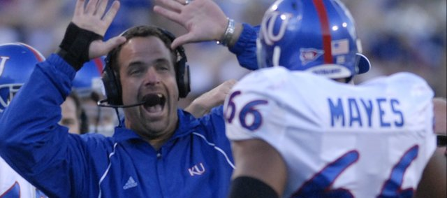 Kansas offensive line coach John Reagan looks to high five lineman Adrian Mayes following a Jake Sharp touchdown during the second half against the Buffaloes, Saturday, Oct. 20, 2007 at Folsom Field in Boulder.