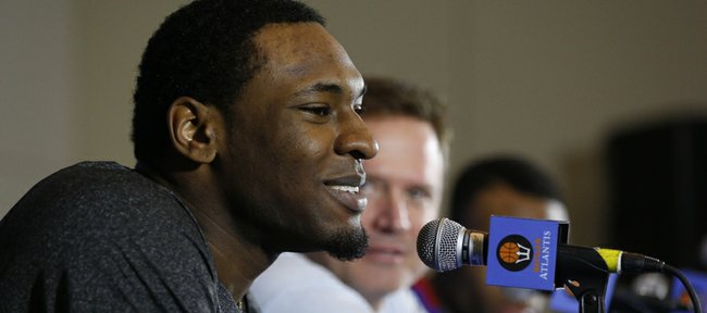 Kansas forward Tarik Black answers a question from a media member during a news conference, Wednesday, Nov. 27, 2013, at the Atlantis Resort in Paradise Island, Bahamas. Kansas will open the Battle 4 Atlantis tournament against Wake Forest at 2:30 p.m. central time on Thursday.