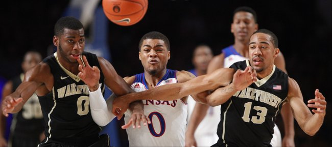 Kansas guard Frank Mason fights for a loose ball with Wake Forest defenders Codi Miller-McIntyre (0) and Coron Williams during the first half of the Battle 4 Atlantis opening round on Thursday, Nov. 28, 2013 in Paradise Island, Bahamas.
