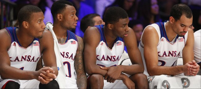 Kansas starters Wayne Selden, left, Naadir Tharpe, Andrew Wiggins and Perry Ellis watch from the bench for a long stretch of the second half of the Battle 4 Atlantis opening round on Thursday, Nov. 28, 2013 in Paradise Island, Bahamas.