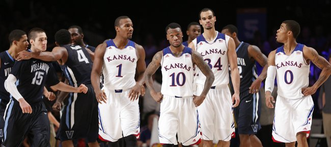 Kansas players Wayne Selden, left, Naadir Tharpe, Perry Ellis and Frank Mason show expressions of disbelief after a three-pointer by Villanova guard Ryan Arcidiacono, right, put the Wildcats on top with seconds remaining in the game, Friday, Nov. 29, 2013 in Paradise Island, Bahamas.