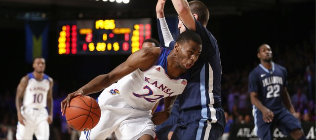 Kansas guard Andrew Wiggins collides with Villanova guard Ryan Arcidiacono during the first half on Friday, Nov. 29, 2013 in Paradise Island, Bahamas.