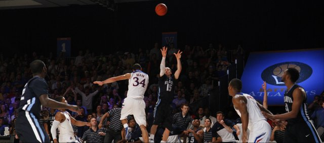 Villanova guard Ryan Arcidiacono puts up a three over Kansas forward Perry Ellis with seconds left in the game, Friday, Nov. 29, 2013 in Paradise Island, Bahamas. Arcidiacono hit the three, giving the Wildcats the lead and the eventual win over the Jayhawks.
