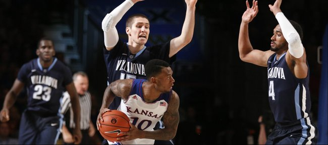 Kansas guard Naadir Tharpe looks for an outlet as he is trapped by Villanova defenders Ryan Arcidiacono and Darrun Hilliard (4) during the second half on Friday, Nov. 29, 2013 in Paradise Island, Bahamas.