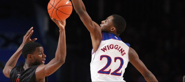 Kansas guard Andrew Wiggins redirects a pass by UTEP guard Julian Washburn during the first half on Saturday, Nov. 30, 2013 in Paradise Island, Bahamas.