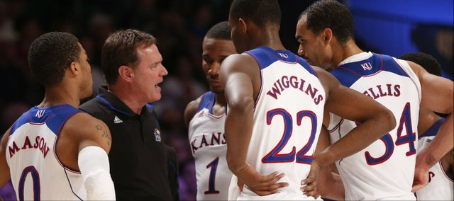 Kansas head coach Bill Self talks with his team after calling a timeout before the Jayhawks' final inbound pass of the game against UTEP on Saturday, Nov. 30, 2013 in Paradise Island, Bahamas.