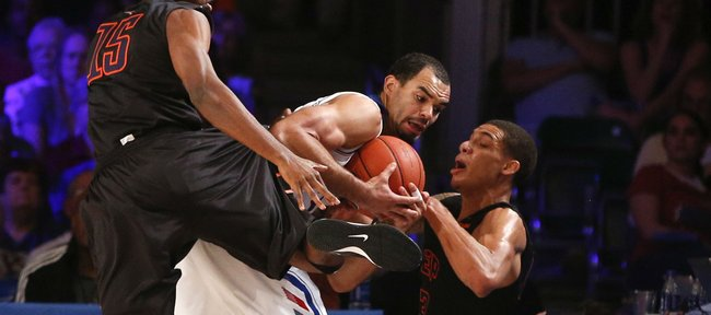 Kansas forward Perry Ellis is fouled after being surrounded by UTEP defenders Tevin Caldwell (15) and Vince Hunter on the Jayhawks' final inbound pass on Saturday, Nov. 30, 2013 in Paradise Island, Bahamas.