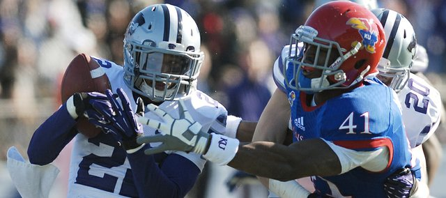 Kansas State defensive back Dante Barnett (22) pulls in an interception from Kansas receiver Jimmay Mundine (41) in the Jayhawks' 31-10 loss to the Kansas State Wildcats, Saturday at Memorial Stadium.