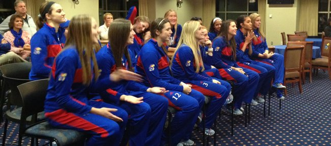 Members of the Kansas University volleyball team watch the NCAA selection show on Sunday, Dec. 1, 2013. The Jayhawks learned they again would host the first two rounds of the tournament.