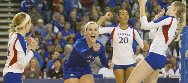 Kansas players get fired up after winning a point during Kansas' volleyball match against in-state rival Kansas State, Saturday at the Horejsi Center. The Jayhawks defeated the Wildcats, 3-1.