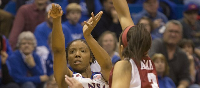 Kansas guard CeCe Harper launches a three past the out-stretched arm of Arkansas defender McKenzie Adams (3) during their game Wednesday night at Allen Fieldhouse.