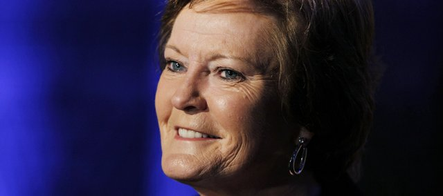 Former Tennessee women's basketball coach Pat Summitt speaks to a reporter before receiving the Coach Wooden Citizenship Cup by Athletes for a Better World at the Fox Theatre in Atlanta, Wednesday, April 25, 2012. (AP Photo/John Bazemore)