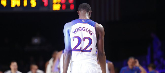 Kansas guard Andrew Wiggins hangs his head while heading to the bench after a string of Jayhawk turnovers against Villanova during the first half on Friday, Nov. 29, 2013 in Paradise Island, Bahamas.