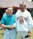 Retired Kansas University professor Malcolm Gibson stands with Nelson Mandela during a 1993 backyard barbecue in Johannesburg, South Africa.