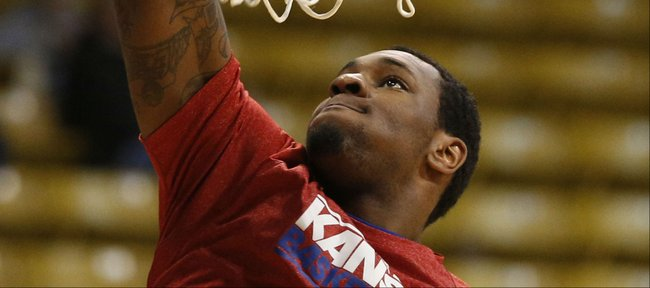 Kansas forward Tarik Black throws down a dunk prior to tipoff against Colorado on Saturday, Dec. 7, 2013 at the Coors Events Center in Boulder, Colorado.