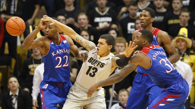 Kansas players Andrew Wiggins (22) Jamari Traylor (31) and Joel Embiid tangle for a possession with Colorado forward Dustin Thomas during the first half on Saturday, Dec. 7, 2013 at the Coors Events Center in Boulder, Colorado.