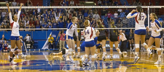 Kansas players celebrate after defeating Wichita State during their volleyball match in the first round of the NCAA tournament at Allen Fieldhouse. The Jayhawks will face Creighton Saturday at 6:30 p.m.