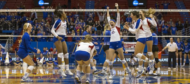 Kansas players celebrate their victory during their second round NCAA volleyball tournament match against Creighton, Saturday at Allen Fieldhouse. The Jayhawks downed the Bluejays, 3-1, and with the win, avenged a loss to Creighton earlier in the year.
