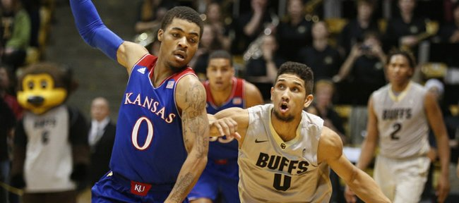 Colorado guard Askia Booker eyes the bucket as he is defended by Kansas guard Frank Mason with seconds remaining in regulation on Saturday, Dec. 7, 2013 at the Coors Events Center in Boulder, Colorado. Booker made the three giving the Buffaloes the win.