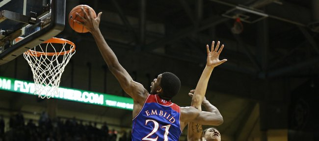 Kansas center Joel Embiid turns for a shot against Colorado forward Dustin Thomas during the first half on Saturday, Dec. 7, 2013 at the Coors Events Center in Boulder, Colorado.