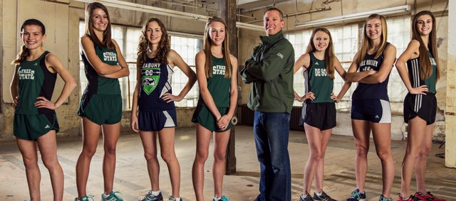 The 2013 Girls All-Area Cross Country team, from left: Claire Sanner, Free State; Bailey Sullivan, Free State; Kate Albrecht, Bishop Seabury; Emily Venters, Free State; coach Chris McAfee, De Soto; Rebekah Burgweger, De Soto; Amber Akin, Mill Valley; and Meredith Wolfe, De Soto.
