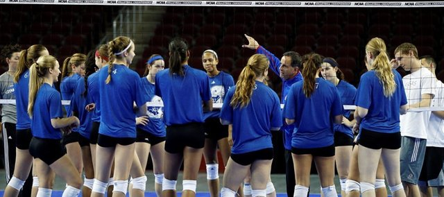 The Kansas University volleyball team huddles after NCAA Tournament practice Thursday at the Galen Center in Los Angeles.