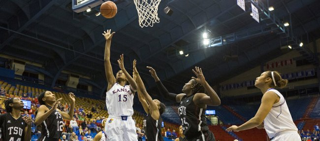 Kansas' Chelsea Gardner (15) finds a soft spot in the Texas Southern defense as she scores in traffic during their game, Thursday at Allen Fieldhouse. The Jayhawks, 105-78, and will next face Purdue on Dec. 15 at home.