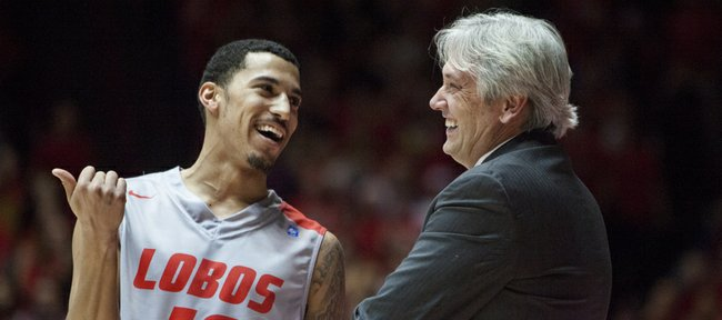 New Mexico coach Craig Neal, right, talks with Kendall Williams during the first half of an NCAA college basketball game against Cincinnati Saturday, Dec. 7, 2013, in Albuquerque, NM.