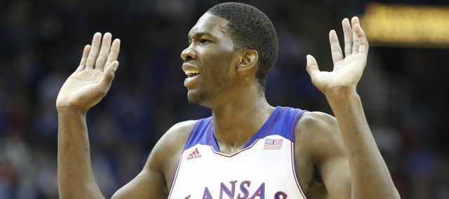 Kansas center Joel Embiid reacts to being called for a foul during the first half on Saturday, Dec. 14, 2013 at Sprint Center in Kansas City, Mo.