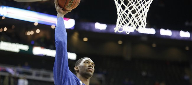 Kansas center Joel Embiid turns for a shot during warmups prior to tipoff against New Mexico on Saturday, Dec. 14, 2013 at Sprint Center in Kansas City, Mo.