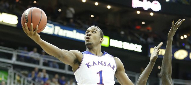 Kansas guard Wayne Selden scoops in a bucket past New Mexico center Obij Aget during the first half on Saturday, Dec. 14, 2013 at Sprint Center in Kansas City, Mo.
