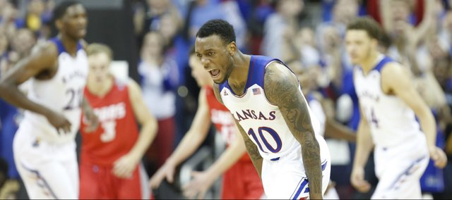 Kansas guard Naadir Tharpe celebrates after hitting a three pointer against New Mexico during the second half on Saturday, Dec. 14, 2013 at Sprint Center in Kansas City, Mo.