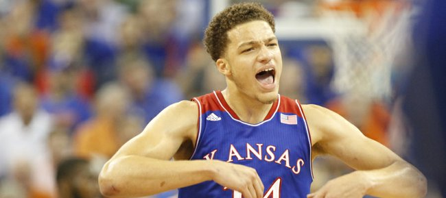 Kansas guard Brannen Greene celebrates during a Jayhawk run against Florida during the second half on Tuesday, Dec. 10, 2013 at O'Connell Center in Gainesville, Florida.